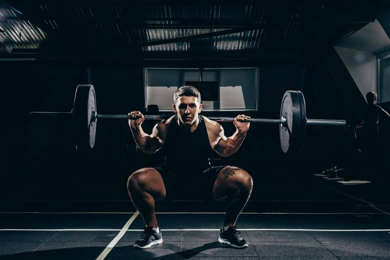 Lift heavy weights to build mass faster