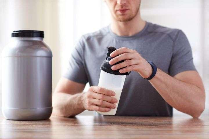 Guy preparing creatine drink